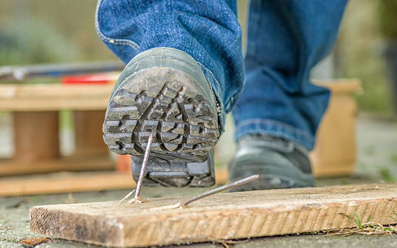 Why do employers require steel-toed shoes?
